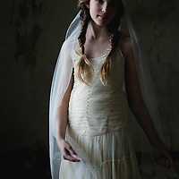 girl dancing in a veil in a abandoned room