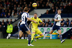 Kyle Walker of Tottenham Hotspur is challenged by Craig Dawson and Gareth McAuley of West Brom - Photo mandatory by-line: Rogan Thomson/JMP - 07966 386802 - 31/01/2015 - SPORT - FOOTBALL - West Bromwich, England - The Hawthorns - West Bromwich Albion v Tottenham Hotspur - Barclays Premier League.