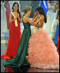 Miss Venezuela Ivian Sarcos receives her Miss World 2011 sash by  Miss World 2010, Alexandria Mills (L) in the Miss world 2011 World Final the Miss World final at Earls Court London, Sunday November 6, 2011. Photo By Andrew Parsons/ i-Images