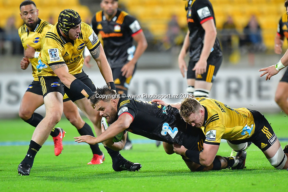 Chiefs' Angus Ta'avao-Matau (C is tackled by Hurricanes Gareth Evans (R and Jeff Toomaga-Allen (L) during the Hurricanes vs Chiefs Super Rugby match at the Westpac Stadium in Wellington on Friday the 13th of March 2018. Copyright Photo by Marty Melville / www.Photosport.nz