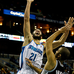 Jan 7, 2013; New Orleans, LA, USA; New Orleans Hornets point guard Greivis Vasquez (21) shoots over San Antonio Spurs point guard Tony Parker (9) during the fourth quarter of a game at the New Orleans Arena. The Hornets defeated the Spurs 95-88. Mandatory Credit: Derick E. Hingle-USA TODAY Sports