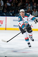 KELOWNA, CANADA - MARCH 7: Madison Bowey #4 of Kelowna Rockets makes a pass against the Spokane Chiefs on March 7, 2015 at Prospera Place in Kelowna, British Columbia, Canada.  (Photo by Marissa Baecker/Shoot the Breeze)  *** Local Caption *** Madison Bowey;