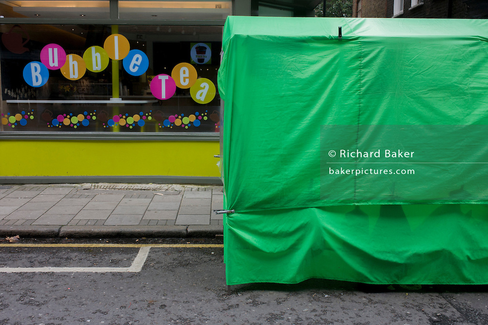 Green tent for street food and circles of Seven Dials tea cafe.