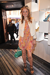 AMBER ATHERTON at the opening party for Nicholas Kirkwood's new store at 5 Mount Street, London on 12th May 2011.