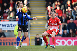 Swindon's Ryan Harley and Orient's Lloyd James compete for the ball - Photo mandatory by-line: Mitchell Gunn/JMP - Tel: Mobile: 07966 386802 22/02/2014 - SPORT - FOOTBALL - Brisbane Road - Leyton - Leyton Orient V Swindon Town - League One