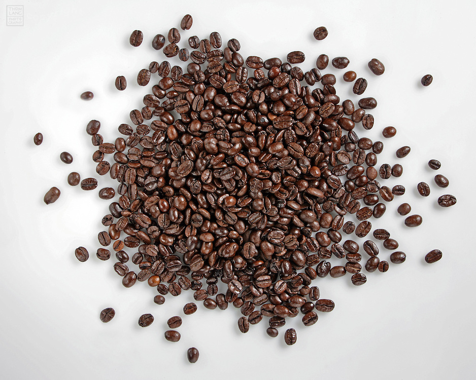 Whole coffee beans on white background
