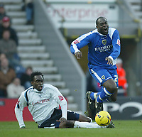 Photo: Aidan Ellis.<br /> Preston NE v Cardiff City. Coca Cola Championship.<br /> 19/11/2005.<br /> Cardiff's Michael Ricketts is brought down by Preston's Patrick Agyemang