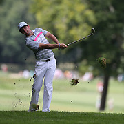 Rory McIlroy hits out of the rough on the seventh hole during the fourth round of theThe Barclays Golf Tournament at The Ridgewood Country Club, Paramus, New Jersey, USA. 24th August 2014. Photo Tim Clayton
