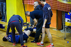 Darijo Savicic of Salonit injured during volleyball match between ACH Volley   and Salonit Anhovo in Final of Slovenian Cup 2014/15, on January 17, 2015 in Sempeter, Slovenia. Photo by Vid Ponikvar / Sportida