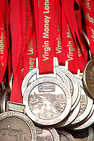 Finisher's medals in The Mall<br /> <br /> The Virgin Money London Marathon 2014<br /> 13 April 2014<br /> Photo: Dillon Bryden/Virgin Money London Marathon<br /> media@london-marathon.co.uk