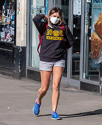 © Licensed to London News Pictures. 05/05/2020. London, UK. A women in a mask goes shopping in Putney High Street, South West London. Wearing masks while out shopping or travelling on public transport could be the new normal as Ministers and scientists decide if it would help after official figures reveal that the UK now has Europe's highest Covid-19 death toll. This Sunday, Prime Minister Boris Johnson prepares to tell the nation of his plans on easing lockdown and how the new normal will work as the coronavirus pandemic crisis continues. Photo credit: Alex Lentati/LNP