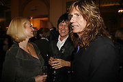 Jeff Beck and his wife Sandra and David Coverdale ( Whitesnake) , Classic Rock Roll of Honour, Classic Rock magazineÍs annual awards party. Langham Hotel, portland Place. London. 6 November 2006.  ONE TIME USE ONLY - DO NOT ARCHIVE  © Copyright Photograph by Dafydd Jones 66 Stockwell Park Rd. London SW9 0DA Tel 020 7733 0108 www.dafjones.com