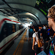 Andrew Whiteford waits for the train during rush hour in Bangkok, Thailand.