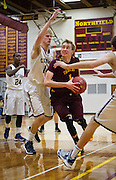 Northfield Raiders guard Hunter Sannes (4), drives the lane through Rochester Century defenders during the second half of the high school basketball game between Northfield and Rochester Century, Tuesday, December 10, 2013. While Sannes scored 15 points, the Raiders fell to the Panthers 51-59.
