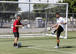 July 23, 2018 - Los Angeles, California, U.S - AC Milan player Mateo Musacchio, right, practices during a training session at StubHub Center in Carso, California on July 23, 2018. AC Milan will play an international Champions Cup match against Manchester United on July 25 in Carson. (Credit Image: © Ringo Chiu via ZUMA Wire)