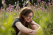 Natural light portrait of teen in field of flowers
