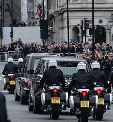 © Licensed to London News Pictures. 17/04/2013. London, UK. Mourners line the streets in Parliament Square as the body of the late Baroness Margaret Thatcher being taken by hearse to St Paul's Cathedral, having just left the Palace of Westminster under police motorcycle escort.  Photo credit : Richard Isaac/LNP