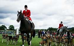 © Licensed to London News Pictures.29/07/15<br /> Borrowby, UK. <br /> <br /> Hunt-masters and the hounds from the Hurworth hunt parade around the main arena during the Borrowby Country Show and Gymkhana in North Yorkshire.<br /> <br /> Photo credit : Ian Forsyth/LNP