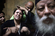 A Coptic priest perfom exorcism on a  worshipper in the Cave Cathedral or St. Sama'ans Church in garbage city,Cairo. <br />
