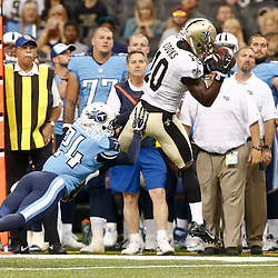 Aug 15, 2014; New Orleans, LA, USA; New Orleans Saints wide receiver Brandin Cooks (10) catches a pass over Tennessee Titans cornerback Coty Sensabaugh (24) during first quarter of a preseason game at Mercedes-Benz Superdome. Mandatory Credit: Derick E. Hingle-USA TODAY Sports