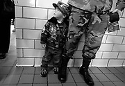 Lt. Col. Henry Schepens and his son Derek, 2, attend a pancake breakfast to benefit the Nation Guard's 50th Main Support Battalion soldiers and their families.