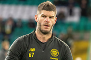 Celtic Keeper Fraser Forster (#67) completes his warm up ahead of the Europa League match between Celtic and Rennes at Celtic Park, Glasgow, Scotland on 28 November 2019.