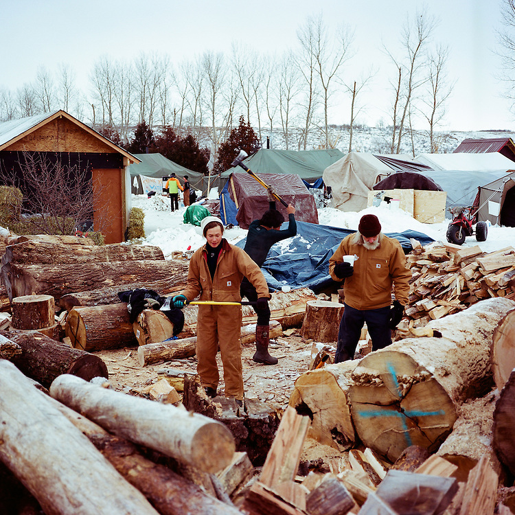 OCETI SAKOWIN CAMP, CANNON BALL, NORTH DAKOTA - DECEMBER 5, 2016: As temeratures drop well below freezing, protesters in the Oceti Sakowin Camp rely heavily on firewood to keep the camp warm.
