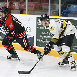 "TRENTON, ON  - MAY 5,  2017: Canadian Junior Hockey League, Central Canadian Jr. ""A"" Championship. The Dudley Hewitt Cup. Game 7 between Georgetown Raiders and the Powassan Voodoos. Jack Hughes #16 of the Georgetown Raiders and  Brett Hahkala #18 of the Powassan Voodoos follows the play during the first period.<br /> (Photo by Tim Bates / OJHL Images)"