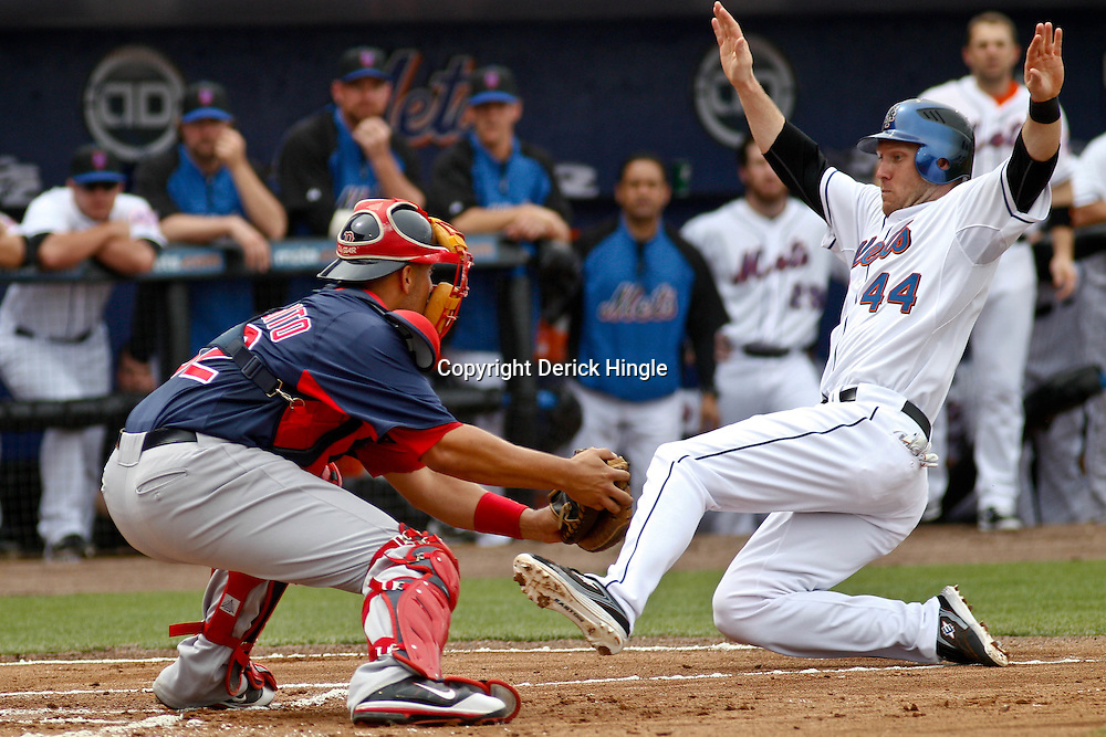 March 6, 2011; Port St. Lucie, FL, USA; New York Mets left fielder Jason Bay (44) slides in safely for a run past Boston Red Sox catcher Luis Exposito (92)during a spring training exhibition game at Digital Domain Park. Mandatory Credit: Derick E. Hingle-US PRESSWIRE