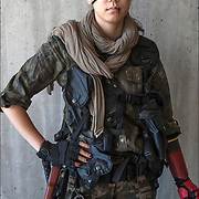 Cosplay attendee in  her 7th Lotus Boss costume, with eye patch and metal gear <br />