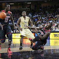 Louisville Cardinals guard Chris Jones (3) trips during an NCAA basketball game between the 14th ranked Louisville Cardinals and the UCF Knights at the CFE Arena on Tuesday, December 31, 2013 in Orlando, Florida. (AP Photo/Alex Menendez)