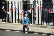 © Licensed to London News Pictures. 03/06/2012. London, UK. A young boy explores Downing Street. The UK Prime Minister hosts a street party on Downing Street today. The party was moved inside number 10 due to the weather but the PM came onto the street to play games with the children who had gathered.  The Royal Jubilee celebrations. Great Britain is celebrating the 60th  anniversary of the countries Monarch HRH Queen Elizabeth II accession to the throne this weekend Photo credit : Stephen Simpson/LNP