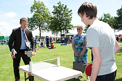 Steve Cram has a game of table tennis with Adam Gale (15)<br /> <br /> Steve Cram spent the day at the Lincolnshire Show with Clydesdale Bank and Yorkshire Bank.  He also visited the Sports Zone, at the show, which was organised by Lincolnshire Sport.<br /> <br /> Picture: Chris Vaughan/Chris Vaughan Photography<br /> Date: Wednesday, June 24, 2015