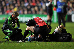 Jordan Crane (Leicester) is treated for an injury before being forced off - Photo mandatory by-line: Patrick Khachfe/JMP - Tel: Mobile: 07966 386802 18/01/2014 - SPORT - RUGBY UNION - Welford Road, Leicester - Leicester Tigers v Ulster Rugby - Heineken Cup.