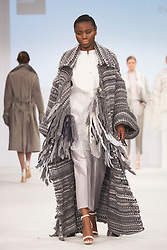 © Licensed to London News Pictures. 01/06/2015. London, UK. Collection by Eve Turley. Fashion show of Kingston University at Graduate Fashion Week 2015. Graduate Fashion Week takes place from 30 May to 2 June 2015 at the Old Truman Brewery, Brick Lane. Photo credit : Bettina Strenske/LNP