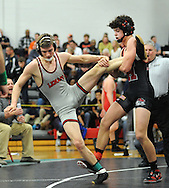 Lenape's Richard Smith, left, falls as Haddonfield's Christophe Bolletino takes control of the match during a 145 pound match during the Region 7 State Wrestling Tournament Wednesday February 24, 2016 at Robbinsville High School in Robbinsville, New Jersey. (Photo by William Thomas Cain)