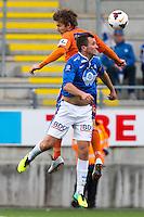 Treningskamp fotball 2014: Molde - Aalesund. Aalesunds Oddbjørn Lie (t.v.) i hodeduell med Even Hovland i treningskampen mellom Molde og Aalesund på Aker stadion.