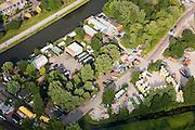 Nederland, Amsterdam, Wenkebachweg, 17-06-2008; terein van de Hells Angels aan de H. J. E. Wenkebachweg, links van het midden; het nieuw gebouwde clubhuis is het vierkante gebouw met het oranje-witte dak, gelegen aan de bijna lege parkeerplaats; ook de andere gebouwen (nissen loodsen) horen bij 'Angels Place'; boven links (diagonaal) het water van de Weesterzijde / Duivendrechtse vaart; rafelrand, neimandsland, motorclub, motoren, motorrijden..luchtfoto (toeslag); aerial photo (additional fee required); .foto Siebe Swart / photo Siebe Swart