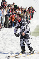 Warwick, NY - A skier wearing a cow costume crossed the water at the end of a run during the Spring Rally at Mount Peter in Warwick on March 29, 2008.