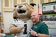 Rufus the Bobcat poses with Sean Anderson of Ohio University Culinary Services during the 1st Annual Supplier Fair held at Ohio University's Baker Center Ballroom on September 7, 2016.