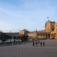People taking a late afternoon stroll in the Plaza de España, Sevilla, Andalucia, Spain.