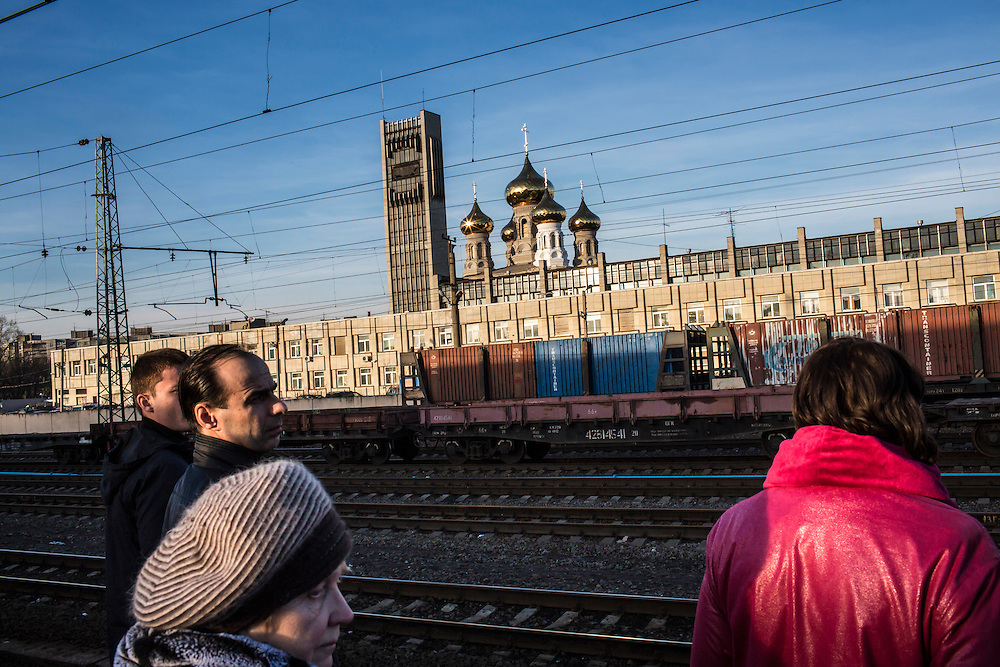 People wait on a platform at the train station on Tuesday, February 25, 2014 in Tver, Russia. Alexander Panin, a Tver native, was arrested in the Dominican Republic in June 2013, and is set to be charged by federal authorities in the US with being part of a gang which robbed bank accounts via the Internet. Photo by Brendan Hoffman, Freelance