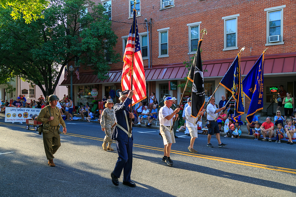 Lititz, PA / USA - July 3, 2017:   Former Military members form an honor guard to lead the parade in a small American town in observance of the 4th of July Independence Day celebration.