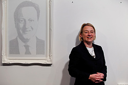 © Licensed to London News Pictures. 17/04/2015. LONDON, UK. Green Party leader Natalie Bennett opening an exhibition of portraits of five party leaders made by Birmingham based artist Annemarie Wright from handwritten text of opinions expressed on social media at Woolff Gallery in London on Friday, 17 April 2015. Photo credit : Tolga Akmen/LNP