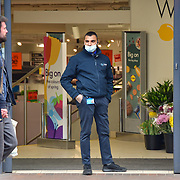 During the coronavirus in UK lockdown a Security Man wearing mask outside Lidl Supermarket for shopping for food,on 28 March 2020, at Walthamstow Market, London.