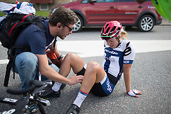 An exhausted Lotta Lepistö (FIN) of Cervélo-Bigla Cycling Team sits on the ground after finishing second in the 141 km road race of the UCI Women's World Tour's 2016 Crescent Vårgårda women's road cycling race on August 21, 2016 in Vårgårda, Sweden. (Photo by Balint Hamvas/Velofocus)