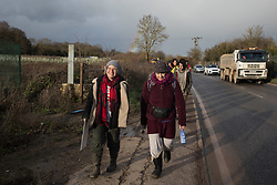 Harefield, UK. 17 January, 2020. Sarah Green (l) of Save Colne Valley leads activists from Stop HS2 and Extinction Rebellion on a tour of sites where HS2 has destroyed and is intending to destroy trees at the beginning of a three-day 'Stand for the Trees' protest in the Colne Valley. The event has been timed to coincide with tree felling work by HS2 adjacent to the site of Stop HS2's Colne Valley wildlife protection camp. 108 ancient woodlands are set to be destroyed by the high-speed rail link.