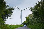 Car shows scale of a wind turbine at Airtricity, Richfield Wind Farm at Kilmore, County Wexford, Ireland