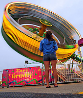 Alyssa Roffers, 14, of Fond du Lac, waits for a friend to finish riding the Zero Gravity ride on the midway Thursday night, at the Fond du Lac County Fair. Thursday, July 19, 2012. Patrick Flood/The Reporter.