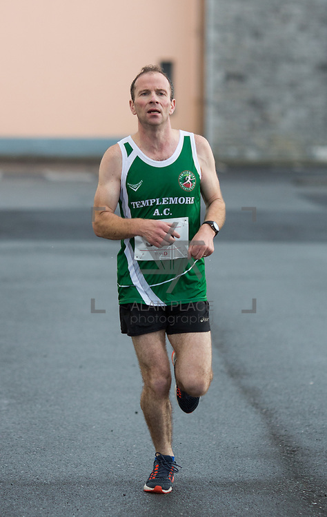 25.08. 2017.                                                      <br /> Almost 200 UL Hospitals Group staff, past and present, and members of the public completed the annual 5k Charity Run/Walk on Friday August 25th in Limerick.<br /> <br /> Peter Madden, Templemore A.C. reaching the finish line in 3rd place.<br /> <br /> <br /> Everybody who participated also raised funds for Friends of Ghana, an NGO formed last year by UL Hospitals Group and its academic partner the University of Limerick to deliver medical training programmes in the remote Upper West Region of Ghana. Picture: Alan Place